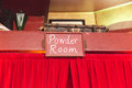 Powder Room Sign Over Curtains Royalty Free Stock Photo