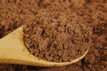 Powder in wooden spoon cacao Stock Photo