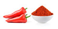 Powdered dried red pepper and red chili peppers in a white bowl Royalty Free Stock Photo