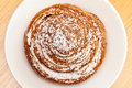 Powdered sugar sweet roll bun on table, top view Royalty Free Stock Photo