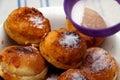 Powdering donuts Royalty Free Stock Photo