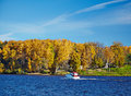 Power boat on an autumn lake in sunny day Royalty Free Stock Photography