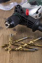 Power drill with bits on a bench Royalty Free Stock Photo