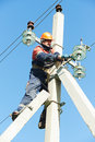 Power electrician lineman at work on pole repairman worker climbing electric post Royalty Free Stock Photography