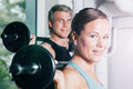 Power gymnastics with barbells in gym attractive couple sport doing training Royalty Free Stock Images