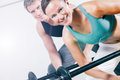 Power gymnastics with barbells in gym attractive couple sport doing training Stock Photography