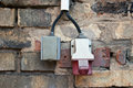 Power and high power current on brick wall Royalty Free Stock Image