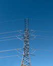 Power line hydroelectric against a blue sky Stock Images
