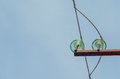 Power line with insulators against Royalty Free Stock Photo