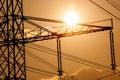 Power line pylon and sun Royalty Free Stock Photos