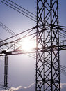 Power line pylon and sun close up view Stock Photo