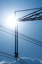 Power line pylon and sun close up view Royalty Free Stock Photo
