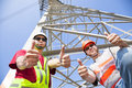 Power line workers with thumbs up Royalty Free Stock Photography