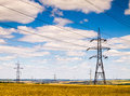 Power lines in the field high voltage overhead line Stock Image