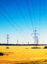 Power lines in the field high voltage overhead line Stock Photo
