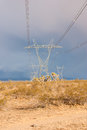 Power lines march of through arizona desert during winter storm Royalty Free Stock Photos