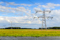 Power lines and pylons in a colorful Dutch polder landscape Royalty Free Stock Photo