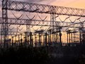 Power lines at sunset typical pylon and electrical substation Stock Photo