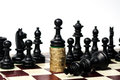 Power of the money concept chess paun standing on wining king Stock Photo