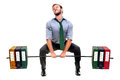 Power muscular businessman lifting weights made of heavy files Stock Photography