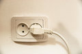 Power outlet and power plug white on white wall Stock Photos
