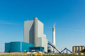 Power plant against a blue sky with fumes Stock Photo