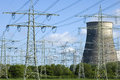 Power plant and electricity pylons between trees this energy factory is fired by coal some biomass the co emissions air pollution Stock Photo