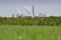 Power plant and field - pollution and energy Royalty Free Stock Photo