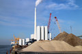 Power plant shiip sand and silos Royalty Free Stock Photos