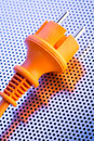 Power plug closeup image of a round european orange Royalty Free Stock Photos