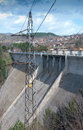 Power pole and dam wall a Stock Image