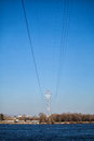 Power pole and wires poles over the river Royalty Free Stock Images