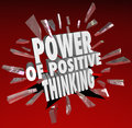 The power of positive thinking words d saying attitude breaking through glass on a red background to symbolize reaching potential Stock Photo