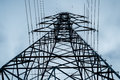 Power pylon an electricity towers above the viewer Royalty Free Stock Photography