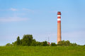 Power station chimney in the green Royalty Free Stock Photo