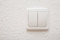 Power switch on white wall Royalty Free Stock Photo