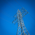 Power tower a long line of electrical transmission towers carrying high voltage lines Stock Photography