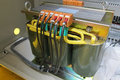 Power transformer in the compartment of steel new electrical equipment Royalty Free Stock Images