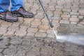 Power washer on patio stone man cleaning with a Stock Photo