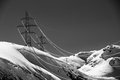 Powercables over the Swiss mountains Royalty Free Stock Photo