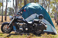 Powerful road motorbike touring australian outback complete camping supplies tent photograph was taken outback bushland queensland Royalty Free Stock Images