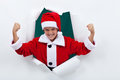 Powerful santa flexing his muscles boy having fun in christmas costume Stock Images