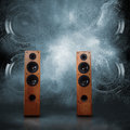 Powerful speakers abstract concept of audio blast out a cloud of dust against dark background Stock Photo