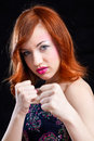 Powerful woman with colorful make up boxing Stock Photo