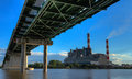 Powerplant and bridge viewed from under the Royalty Free Stock Photo