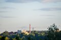 Powerplant seen in distance surrounded by nature symbol of technology pollution and urbanism Stock Photography