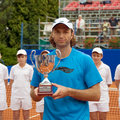 Poznan Porshe Open 2009 - Y.Schukin with trophy Royalty Free Stock Photo