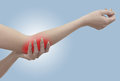 Ppain in a woman elbow pain female holding hand to spot of pain Royalty Free Stock Images