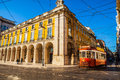 Praca do comercio building with the red tram on the corner Royalty Free Stock Photo