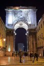 Praca do comercio gate in the night lisbon portugal january behind with people along streets Stock Image